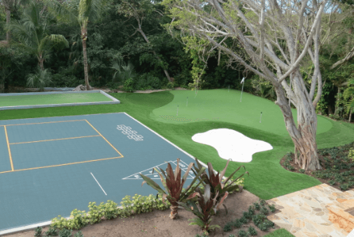 backyard putting green featuring a game court